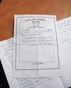 A letter posted by the Taliban threatening violence on girls who attend school.